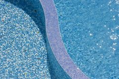 Water texture. Sun shining through water and reflecting at the bottom of the pool stock photo