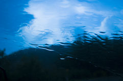 Water texture. View of the skay in driving rain stock image
