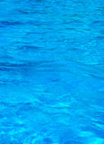 Water texture. Texture of blue water surface with reflections and waves Royalty Free Stock Photography