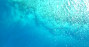 V11108 water texture breaking and crashing with drone aerial flying view of aqua blue and green clear sea ocean. Water texture breaking and crashing with drone Royalty Free Stock Images