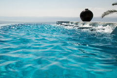 Water texture, infinity swimming pool. Luxury vacation and recreation concept Royalty Free Stock Images
