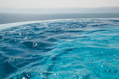 Water texture in infinity swimming pool. Paradise resort concept. Seaview. Stock Images