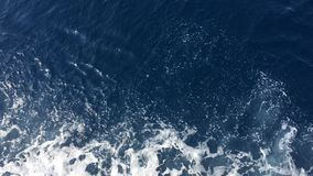 Water texture in the Mediterran sea. Crystal clear water of Adriatic Sea sparkle in the bright morning sun. Little sea waves rolli stock video footage