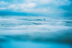Water texture in ocean. Waves and foam in sea stock images