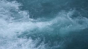 Water texture. Pure blue water with light reflections. Slow motion. stock footage