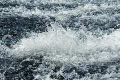 Water on a threshold of the river is rolled Royalty Free Stock Image