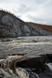 Water threshold on the Siberian taiga river in the fall Stock Image