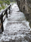 Water thundering down the stairs along rocks. Royalty Free Stock Image
