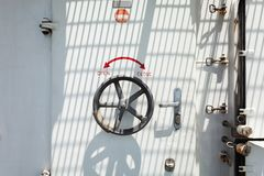 Water tight door on a ship of the boat with lock wheel into the Stock Photo