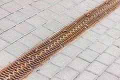 Water tijdens de stromen van een regenreproductie in Stock Afbeelding