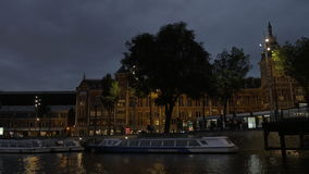 Water tour on Amsterdam canals at night stock footage