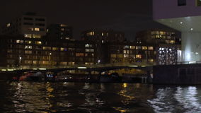 Water tour in night Amsterdam stock video footage