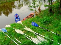 Water tourism on kayaks. Summer vacation on boats to sail along the river. Royalty Free Stock Photography