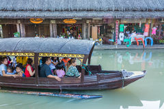 Water tourist boat floats through water market Royalty Free Stock Photography