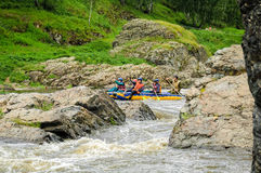 Water tourists move on rapid river in threshold. Beklenischevo, Russia - June 12, 2005: The place with the Iset River rapid current, a so-called threshold the Royalty Free Stock Photography