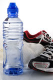 Water towel and running shoes Royalty Free Stock Images