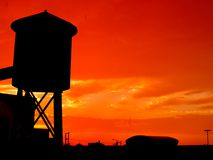Water Tower. An old water tower against the sunset stock images