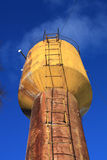 Water tower. Rusty water tower on background blue sky Stock Photos