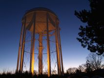 Water Tower. A tall water tower at sunset royalty free stock photography