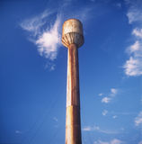 Water tower. Old rusty water tower against a blue sky Royalty Free Stock Images