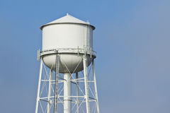 Water Tower. Fog clears revealing a white water tower Royalty Free Stock Photography