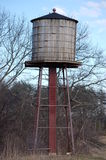 Water tower. A small, wooden water tower royalty free stock photo