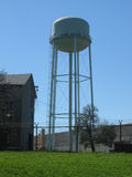 Water tower. In an industrial park Royalty Free Stock Images