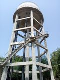 Water Tower. A water tower is an elevated structure supporting a water tank constructed at a height sufficient to pressurize a water supplysystem stock photos