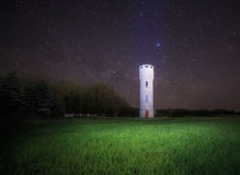 Water tower against night sky. Landscape with water tower against night sky Stock Image