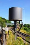Water tower alongside railway line. Stock Photography