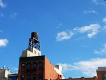 Water tower atop building royalty free stock images