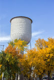 Water tower autumn trees Stock Photography