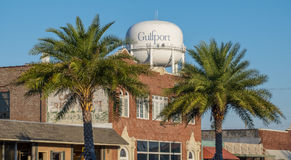 Water tower and buildings in downtown Gulfport Mississippi. Palm trees frame water tower in downtown Gulfport Mississippi Royalty Free Stock Photos
