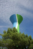 Water tower with cellular phone network antennas. A colourful water tower, painted in blue, green and white, with cellular phone network antennas on top and a Stock Photos
