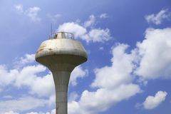 Water tower with clouds and blue sky background. stock photos