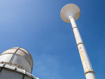 Water tower and cooling tower Stock Image