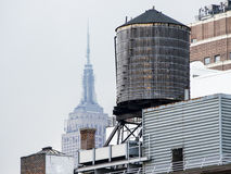 Water Tower With Empire State Building Royalty Free Stock Image