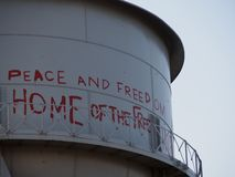 Water Tower with Graffiti. At Alcatraz in San Francisco Royalty Free Stock Photos