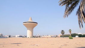 Water Tower in jeddah city at noon. From behind the palm stock footage