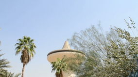Water Tower in jeddah city at noon closeup. From behind the palm stock video footage
