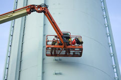 Water Tower with Maintenance Workers Royalty Free Stock Photos