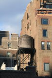 Water tower in NYC. Old water tower on an old building in New York City Stock Photos