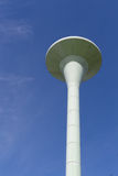 Water tower painted white under blue sky Royalty Free Stock Images