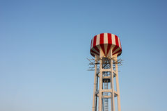 Water tower with red and white Royalty Free Stock Images