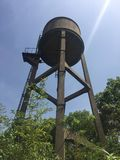 Water tower in spring. Water towers, generally impounding water in residential areas, are also an important part of the water plant's production process Royalty Free Stock Image