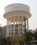 Water tower/tank/storage building. At Noida, NCR, UP, India. Old concrete rusty water tower Royalty Free Stock Photo