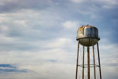 Water tower under cloudy skies royalty free stock photos
