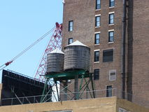 Water towers. New York buildings topped with an array of water towers Royalty Free Stock Photos