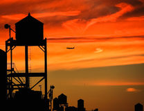 Water towers in NYC at sunset Royalty Free Stock Photos