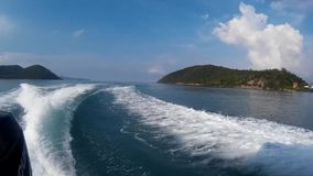 Water trace formed from speed boat engine. Water trail foaming behind boat. Thailand stock video footage
